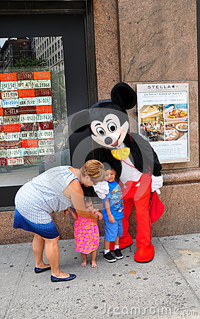NYC: Children with Mickey Mouse Editorial Stock Image