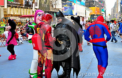 NYC: Comic Book Characters in Times Square Editorial Image