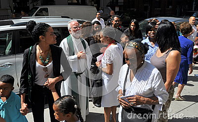 NYC: Priest Greeting Parishioners Editorial Photo