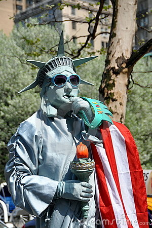 NYC:  Statue of Liberty Mime Editorial Photography