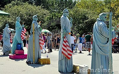 NYC: Statue of Liberty Mimes Editorial Stock Image