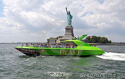 NYC: Statue of Liberty and Tour Boat Editorial Photo