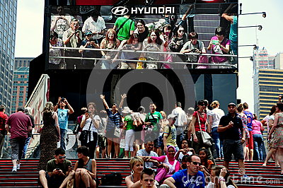 NYC: Tourists with Animatronic Billboard in Times Square Editorial Stock Photo