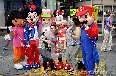 NYC: Tourists with Cartoon Characters Editorial Photography