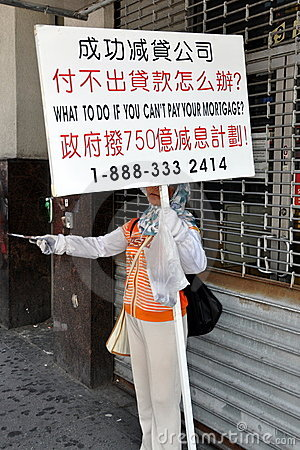 NYC: Woman with Mortgage Sign Editorial Photo