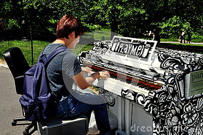 NYC: Young Man Playing Piano in Central Park