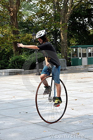 NYC: Young Man Riding a Unicycle Editorial Photo