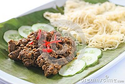 Nyonya roti jala with beef rendang