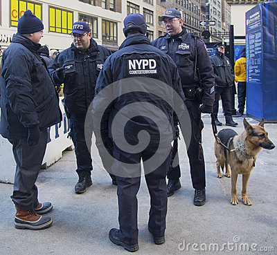 NYPD counter terrorism officers and NYPD transit bureau K-9 police officer with K-9 dog providing security on Broadway Editorial Stock Photo