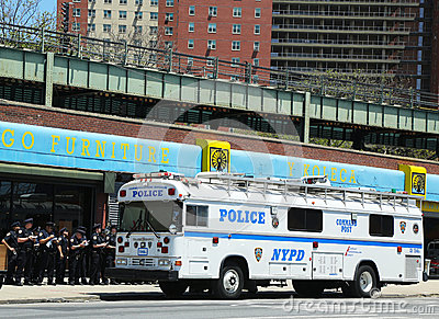 NYPD officers next to mobile command post  in Brooklyn, NY Editorial Photography