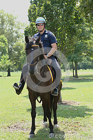 NYPD police officer on horseback ready to protect public at Billie Jean King National Tennis Center during US Open 2013 Editorial Stock Image
