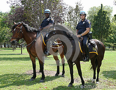 NYPD police officers on horseback ready to protect public at Billie Jean King National Tennis Center during US Open 2013 Editorial Photo