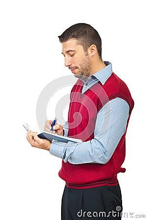 O homem de negócio escreve em sua agenda