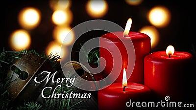 O vermelho Candles o laço do Feliz Natal