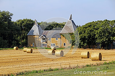 Oast house and hay bales