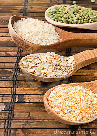 Oat, rice and pea in wood spoon