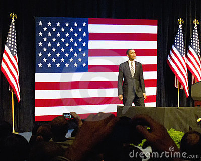 Obama in Front of Flag at the Rally Editorial Photo