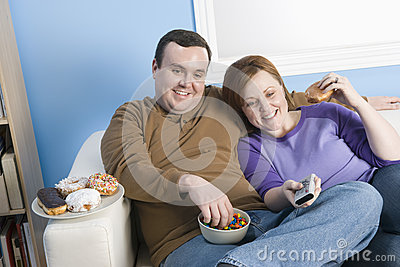 Obese Couple Sitting Together