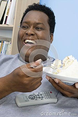 Obese Man Eating Cake