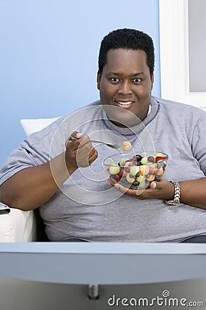 Obese Man Eating Fruits