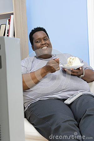 Obese Man Eating Pastry