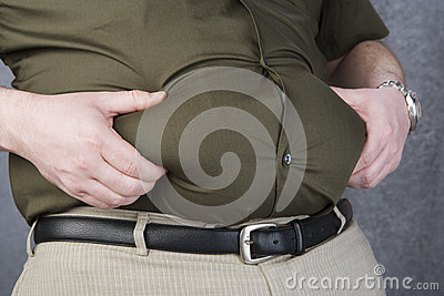 Obese Man Grabbing His Fat On The Stomach