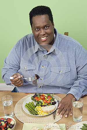 An Obese Man Having Food