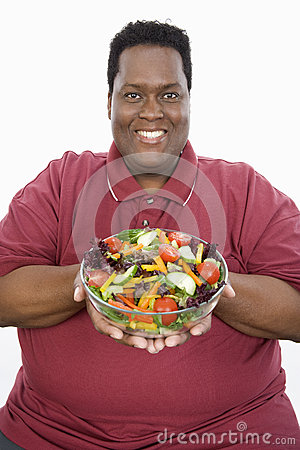 An Obese Man Holding Bowl Of Vegetable Salad