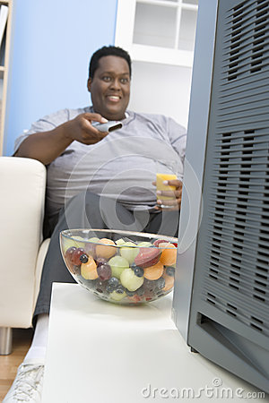 Obese Man Holding Glass Of Juice