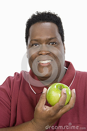 An Obese Man Holding Green Apple