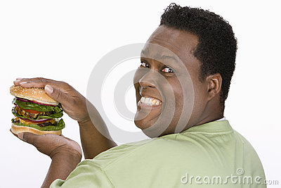 An Obese Man Holding Hamburger