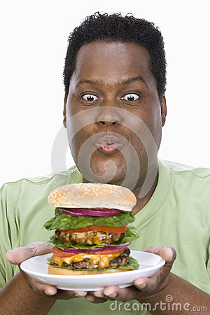 An Obese Man Looking At Hamburger