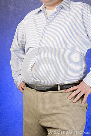 An Obese Man Standing With Hands On Hip