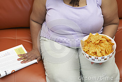 Obese Woman With A Bowl Of Nachos