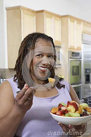 Obese Woman Having Fruit Salad