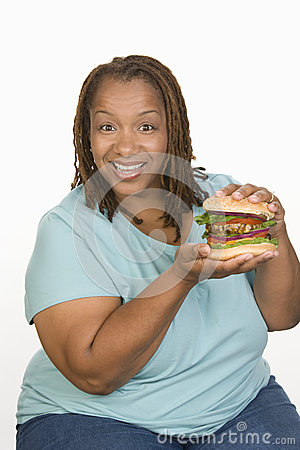 An Obese Woman Holding Hamburger