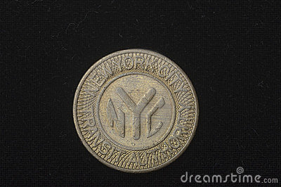 An obsolete New York City subway token