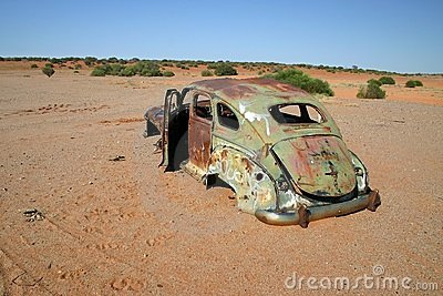 Obsolete rusted car.