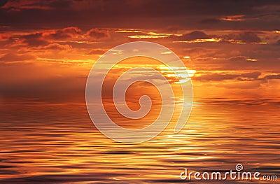 Océano abstracto y salida del sol