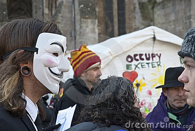 Occupy Exeter activist wearing Guy Fawkes mask Editorial Photo