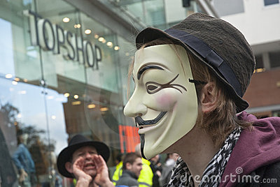 Occupy Exeter activist wearing a Guy Fawkes mask Editorial Photography