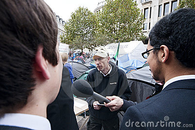 Occupy London protesters answering to public Editorial Photography
