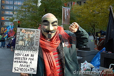 Occupy Wall Street protestor in Guy Fawkes mask Editorial Photography