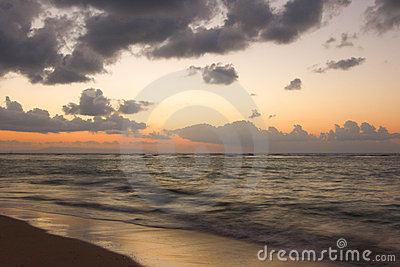 Ocean and beach on tropical sunrise