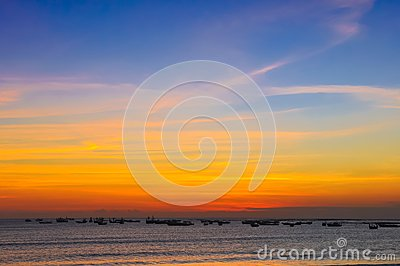 Ocean coast sunset and fishing boats