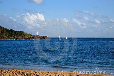 Ocean Scene with Sailboats and Lighthouse