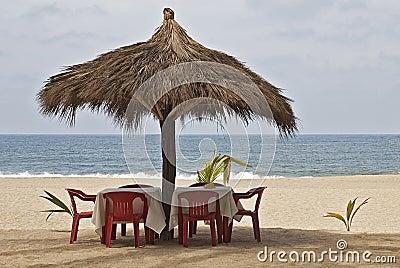 Ocean-side palapa table setting
