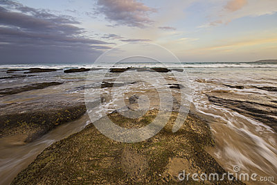 Ocean sunset with rushing water