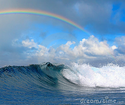 Ocean wave in tropical paradise and rainbow