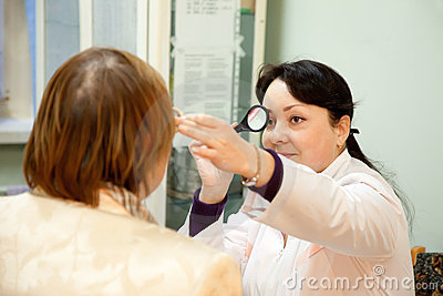 Oculist and patient testing  eyesight
